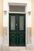 Classic green street door with lights — Stock Photo