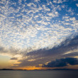 Sunset on the sea with  clouds - Stock Photo