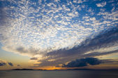 Sunset on the sea with clouds — Stockfoto