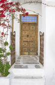 Old Doors and gate with flowers — Stock Photo