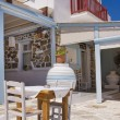Restaurant on streets of Greek Island — Stock Photo