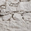 White wall of rough stone whitewashed — Stock Photo