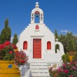 Stock Photo: White Greek church in garden