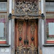Stock Photo: Richly decorated old door in baroque style.