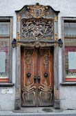 Richly decorated old door in baroque style. — Stock Photo