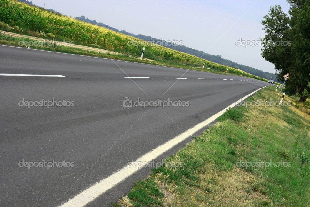 Asphalt road going through the countryside — Stock Photo #2909744