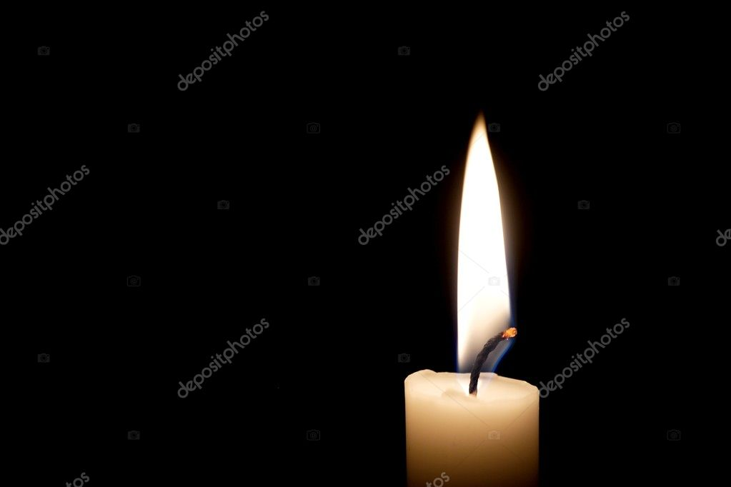 Closeup of burning candle on black background — Stock Photo #3664729