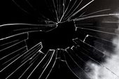 Broken glass hole with black background — Stock Photo