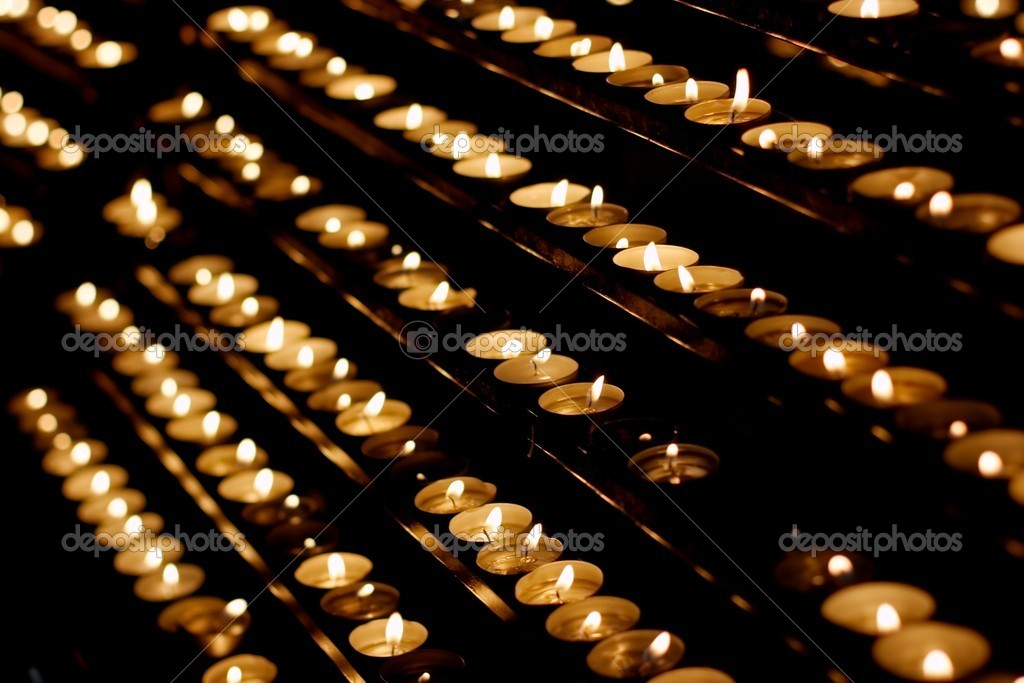 Rows of candles in a dim church — Stock Photo #3888303