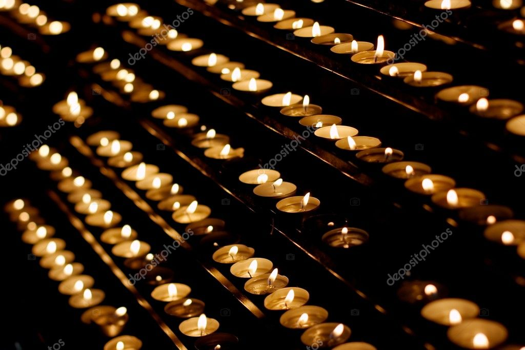 Rows of candles in a dim church — Stock fotografie #3888303