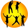 Happy silhouettes jumping — Stock Photo