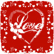 Love card on red background - Stock Photo