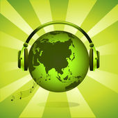 Green earth globe with headphones — Stockfoto