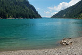 Summer panoramic view of alpine lake — Stock Photo