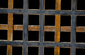 Wooden lattice on a black background — Stock Photo