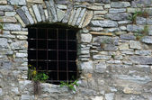 Window of old prison from stontes — Stock Photo