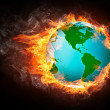 Globe in Flame - Stock Photo