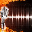 Microphone on Fire Background - Stock Photo