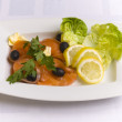 Salty salmon decorated with salad leaves, lemon — Stock Photo