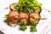 Grilled chiken meat wraped in bacon stringed on — Photo