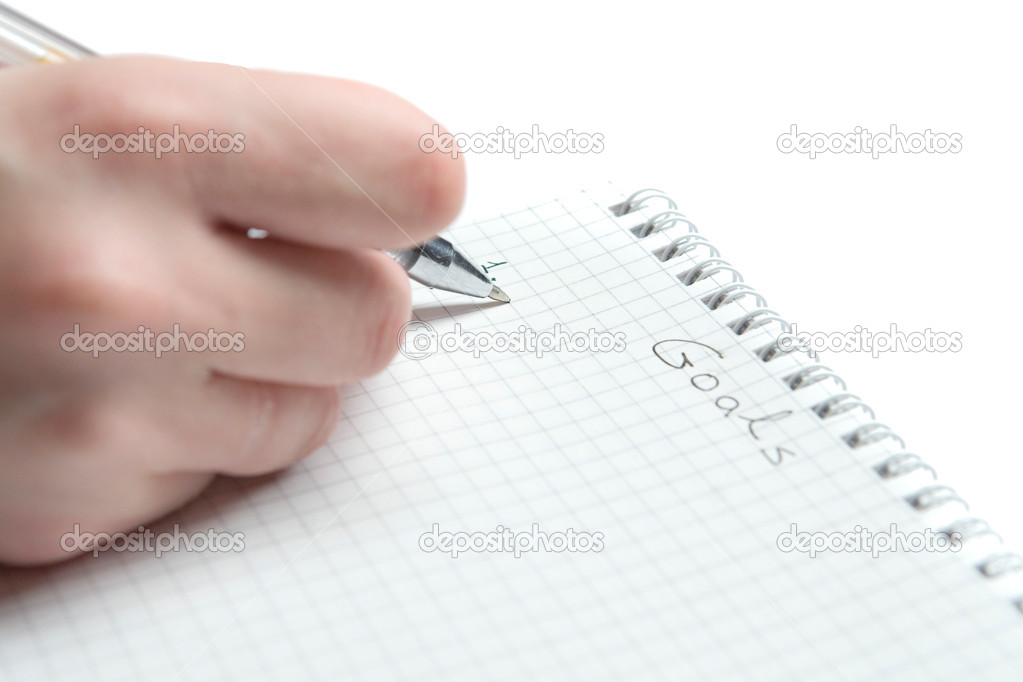Writing goals in notebook on white ground — Stock Photo #3000765