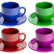 Four empty cups and saucers, isolated — Stock Photo