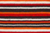 Knit jumper texture. orange, black and white threads — Stock Photo