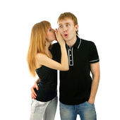 Couple whispering isolated background — Stock Photo