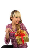The young girl about a gift by a box — Stock Photo
