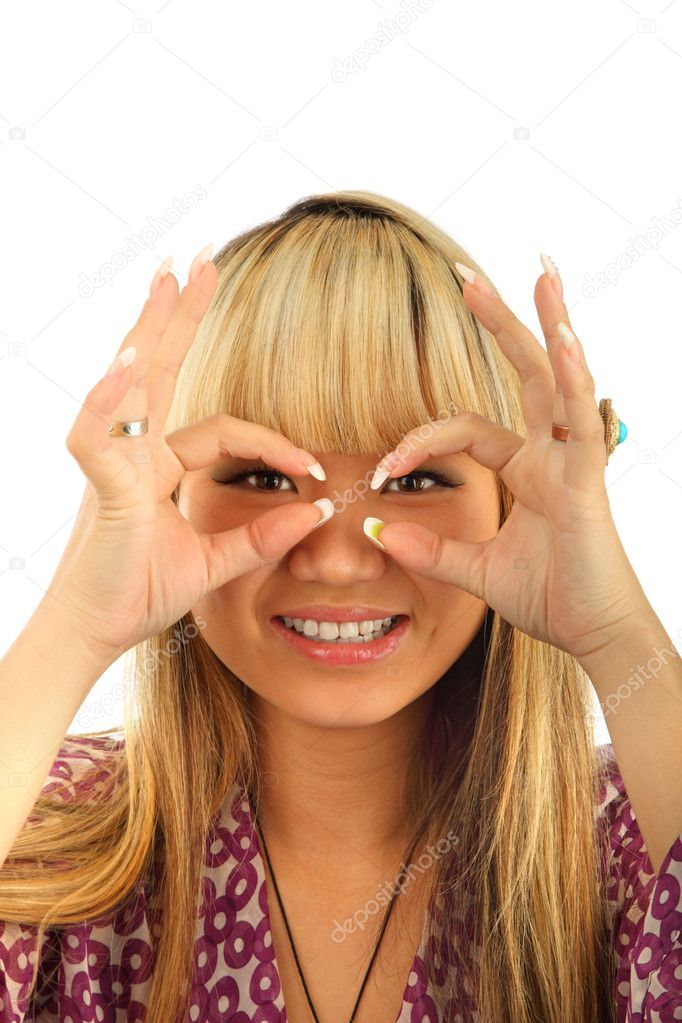 Happy young woman looking through circled finger isolated — Stock Photo #3846616