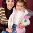 Happy mother with little daughter — Stockfoto #3372167