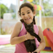 Little girl holding a kitten - Stock Photo