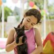 Little girl holding a kitten — Stock Photo