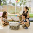 Three kids having fun with drums — Stock Photo #3400943