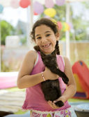 Little girl holding a kitten — Stock Photo