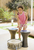 Girl playing drums — Stock Photo