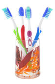 Four toothbrush iv decorative glass — Stock Photo