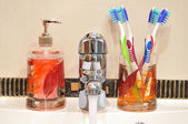 Liquid Soap, Faucet , Four Toothbrushes — Foto Stock