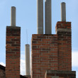 Many of brick chimneys on the top of the house — Stock Photo