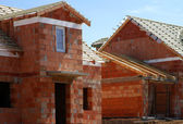 Big brick house under the construction — Stock Photo