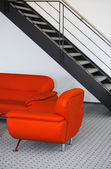 Interiér s červenou pohovku — Stock fotografie