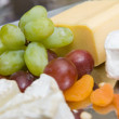 Appetizer from cheese and grape — Stock Photo