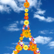 Eiffel tower from flowers against blue sky — Stock Photo #3003397
