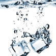 Ice cubes dropped into water — Stock Photo #3004274