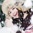 Smiling young woman in falling snow — Stock Photo #3004481