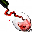 Pouring red wine in glass goblet — Stock Photo