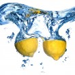 Fresh lemon dropped into water — Foto de Stock