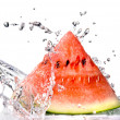 Watermelon and water splash — Stock Photo