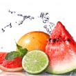 Water splash on fresh fruits — Stockfoto