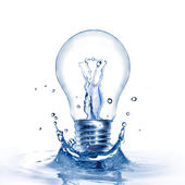Energy concept. Light bulb with water and splash isolated on white — Стоковое фото